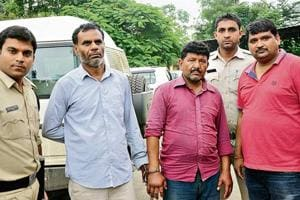 Serial killers Aadesh Khambra ( second from left) and Tukaram ( Third from left) in custody at Bhopal district court in Bhopal.