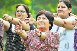 71-year-old Sukh Varsha (centre) has been teaching yoga daily for two decades.