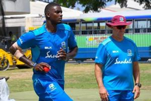 Jason Holder (L) of West Indies takes part in a training session under the watchful eye of coach Stuart Law (R).