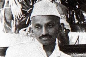 Mahatma Gandhi  with the cap that has now become synonymous with political class.