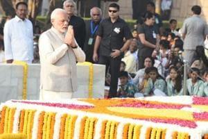 Prime Minister Narendra Modi pays his respects at Mahatma Gandhi's memorial at Rajghat, New Delhi, on October 2, 2018.