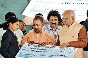 Asian Games gold medallist Sudha Singh with UP chief minister Yogi Adityanath and governor Ram Naik.