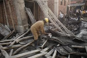A Delhi Fire Service (DFS) personnel during a rescue operation after a portion of an unauthorised under-construction building collapsed in Swaroop Nagar, in New Delhi, on Monday, October 1, 2018.