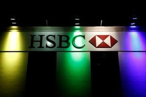 A former Geneva-based HSBC Holdings Plc banker and two of his brothers are at the center of a ring that prosecutors say laundered drug money by providing wads of bills at secret meetings in Paris to dozens of well-to-do individuals seeking to spend loot they'd stashed in offshore accounts.