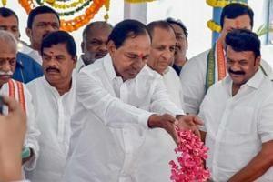 Telangana caretaker Chief Minister K Chandrashekhar Rao pays floral tribute to Mahatma Gandhi in Hyderabad on October 2.