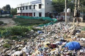 Garbage dumped near Rao Ram Singh Public School, Sector 45, in Gurugram,  on Monday, October 1, 2018.