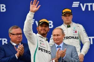 Lewis Hamilton celebrates with second placed Mercedes