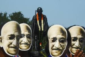 Students and volunteers wear masks of Mahatma Gandhi during a march to celebrate his 150th birth anniversary in Kolkata on October 2.