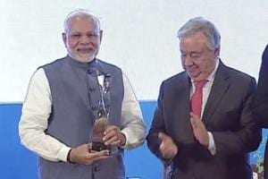 Prime Minister Narendra Modi receives the Champion of the Earth award from UNSecretary General Antonio Guterres in New Delhi.