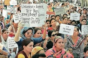 Contractual school teachers holding a protest at Hanuman Chowk in Bathinda on Tuesday.