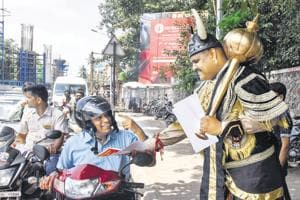 Metro workers dressed as Yamraj spreads awareness about road safety, Pune, September 6, 2018