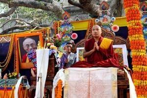 Tibetan spiritual leader Ogyen Trinley Dorje, the 17th Karmapa, offers prayers at the Mahabodhi Temple at Bodhgaya.