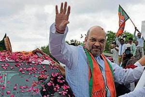 BJP chief Amit Shah's trips to the state have infused a new energy among workers in Rajasthan, the party's state unit chief Madan Lal Saini said.