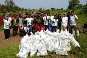 Members of NGO 'Environment Life' with bags filled with trash that they collected from a waterfall at Tapalwadi Neral, Matheran, Maharashtra, October 2, 2018.