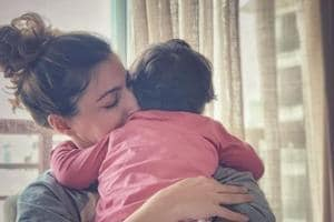 Soha Ali Khan with her daughter Inaaya Naumi Kemmu sleeping her arms.