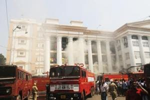 Fire fighters douse a fire which broke out in a pharmacy building of the Kolkata Medical College and Hospital, in Kolkata on October 3.