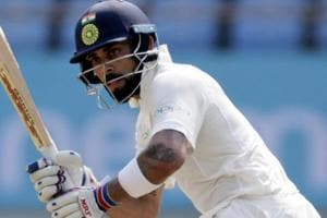 Virat Kohli bats during the second day of the first cricket Test match between India and West Indies in Rajkot.