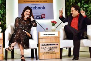 Author, columnist and film producer Twinkle Khanna with author Amish Tripathi during the session 'Reimagining Fiction'.