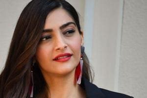 Indian actress Sonam Kapoor poses after attending the Armani fashion show, as part of the Women