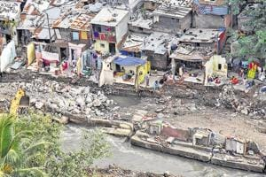 Broken walls and shattered homes is all that remains for the slum dwellers near Dandekar bridge.
