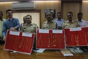 Thane police display gold chains and mangalsutras they seized from the accused, on Friday.