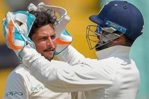 Kuldeep Yadav (L) celebrates the wicket of Shai Hope during thefirst Test between India and West Indies.