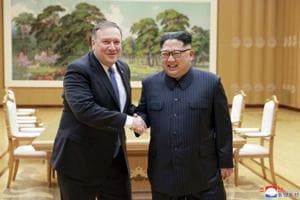 In this May 9, 2018 photo, US secretary of state Mike Pompeo, left, shakes hands with North Korean leader Kim Jong Un during a meeting at Workers