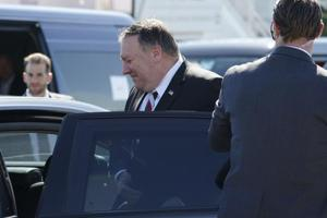 US Secretary of State Mike Pompeo, center, gets on a vehicle upon his arrival at Haneda Airport in Tokyo Saturday.