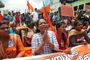 A woman chants hymns during a protest called by various Hindu organisations against the lifting of ban by Supreme Court that allowed entry of women to the Sabarimala temple, in Kochi, India, October 2, 2018