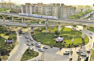 A view of the AIT Chowk on Golf Course Road. Over the last decade, roundabouts have made way for either underpasses, flyovers or traffic signals..