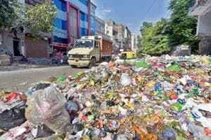 Sanitation workers have refused to end their strike, even as east Delhi's roads are full of garbage.