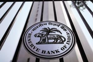 The Reserve Bank of India (RBI) seal is pictured on a gate outside the RBI headquarters in Mumbai October 29, 2013. India