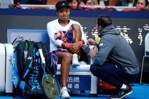 Naomi Osaka of Japan sits on the bench as she talks to her coach during her match against Anastasija Sevastova of Latvia.