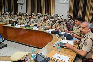 Punjab DGP Suresh Arora (right) during a meeting with police personnel in Ludhiana on Monday.