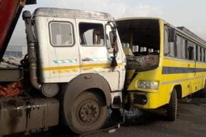 The truck and the bus collided head on leaving the kids injured.