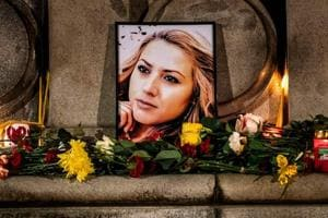 A portrait of slain Bulgarian television journalist Viktoria Marinova during in a candle-light vigil in the city of Rousse.