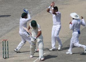 Pakistan cricketer Muhammad Abbas (2R) celebrates with teammates after taking the wicket of Austalian batsman Aaron Finch.
