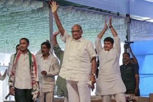 NCP chief Sharad Pawar waves during the party