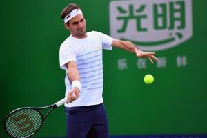 Roger Federer of Switzerland hits a return as he takes part in a training session at the Shanghai Masters tennis tournament.