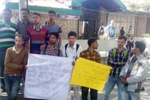 A group of villagers holding placards to draw attention of the state government in Shimla on Tuesday.