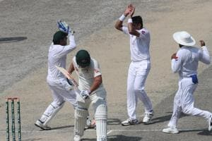 Pakistan cricketer Muhammad Abbas (2R) celebrates with teammates after taking the wicket of Austalian batsman Aaron Finch (2L) during the third day of play of the first Test cricket match in the series between Australia and Pakistan at the Dubai International Stadium in Dubai on October 9, 2018.