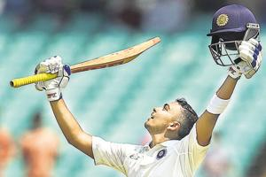 Rajkot: Indian batsman Prithvi Shaw celebrates his century on day one of the 1st test cricket match against West Indies, in Rajkot.