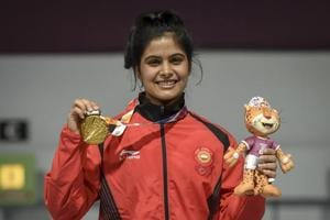 Manu Bhaker shows her gold medal after winning in the 10m Air Rifle competition at the Youth Olympic Games.