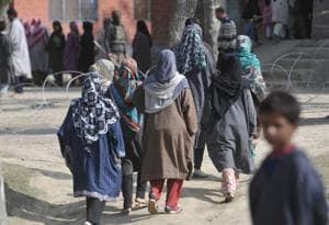 Women arrive at a polling station in Inderkoot, Bandipora.