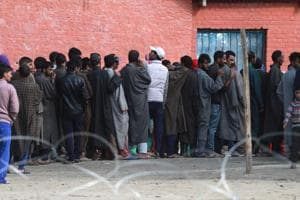People stand in queue to cast their vote in Inderkoot, Bandipora district.