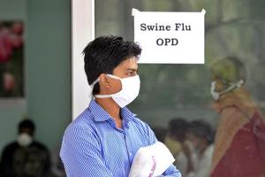 A patient with a suspected case of swine flu at a screening centre in New Delhi
