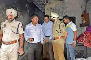 Deputy commissioner Pradeep Kumar Agrawal (second from left) and police commissioner Sukhchain Singh Gill at the blaze site in Ludhiana on Wednesday.