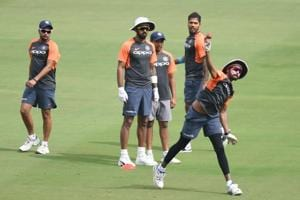 Indian cricketers (L to R) Kuldeep Yadav, Lokesh Rahul, Prithvi Shaw, Umesh Yadav look on as Mohammed Siraj throws a ball during a training session ahead of the second Test cricket match between India and West Indies at the Rajiv Gandhi International Cricket Stadium in Hyderabad.