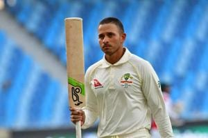 Australian cricketer Usman Khawaja leaves the pitch after being dismissed by Pakistan batsman Yasir Shah during day five of the first Test cricket match in the series between Australia and Pakistan.