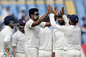 Indian cricketer Ravichandran Ashwin celebrates with teammates after dismissing West Indies